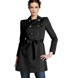 Flared Trench Coat. Trench coat-- is a raincoat made of waterproof heavy-duty cotton drill or poplin, wool gabardine, or leather, that generally has a removable insulated lining (Mineza Kaw, FMM1B1)