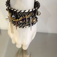 Leather Dream Catcher Cuff with chains and charms   Kane Women's Jewelry via: Michelle Tan - Price: $89.00
