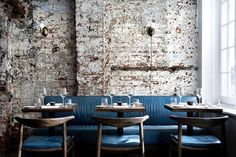 I like this hit of teal in a monochromatic room.  Especially with walnut. Musket Room NYC Blue Banquettes Remodelista