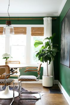 Those green walls! The tulip table! The hide! The simple white curtains with wooden blinds. Love. Love. Love