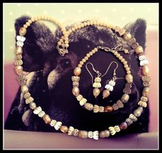 Fine river pearls with silver cats