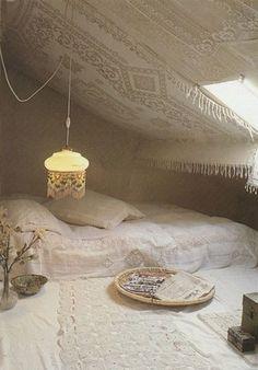 Beautiful white attic bedroom