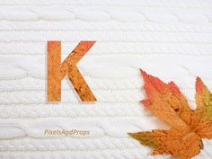Uppercase letter K with glitter leaf and sweater knit. #fall #autumn #alphabet #typography #initial #monogram #font | maple leaf