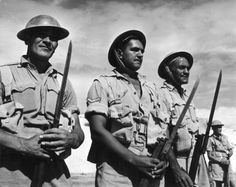 Three members of the Maori Battalion in the Western Desert, Egypt. From left to right: P Clarke, T Bryers and W H Cooper. Photographer unidentified.