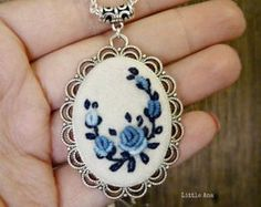 Needle felted necklace with hand embroidered flowers. Traditional embroidery is handmade onto felted wool (merino). The findings are antique bronze tone.  Size: 50 x 36 mm (1.96 x 1.41 ) Chain leght: 68 cm (26.77)  The necklace comes gift wrapped in beautiful box with asorted ribbon.  The colors may vary slightly due to differences in monitor calibrations.