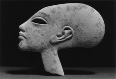 Daughter of Amenophis IV or Akhenaten (1351-1334). This female head has an elongated skull, and is probably a child of Amenhotep IV/Akhenaten (1351-1334 BCE). The eye is hollow for inlaying. The piece is broken across the neck, and is a forgery executed in the 18th Dynasty, Amarna Period style.   Walters Art Museum