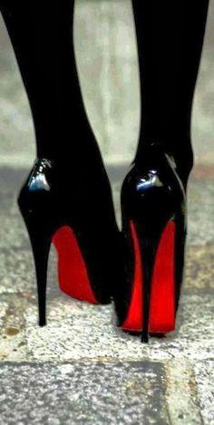 Christian Louboutin classic black high heels.