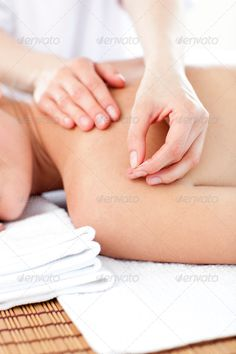 Close-up of a young woman receiving a acupuncture treatment ...  acupuncture, alternative, attractive, back, beautiful, body, care, caucasian, cheerful, day, down, female, getting, happy, health, healthy, heterosexual, lifestyle, luxury, lying, massage, medicine, natural, needle, radiant, relax, relaxation, rest, resting, skin, smiling, spa, therapy, towel, treatment, wellbeing, wellness, woman