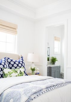 cottage bedroom decor, blue and white bedroom decor with blue throw pillows upholstered bed and white walls in modern coastal master bedroom decor Farmhouse Bedroom Decor, Cozy Bedroom, Dream Bedroom, Bedroom Ideas, Bedroom Designs, Blue Bedroom, Modern Bedroom, Bedroom Beach, Pretty Bedroom