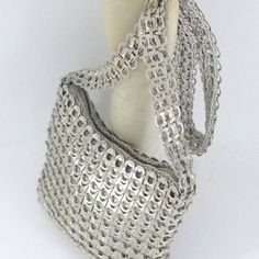 Soda tab bags - made from soda can pop tabs!  These are so cool; several different designs shown.