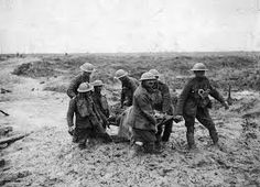 """""""Bloodbath and mudbath Seven stretcher bearers struggle to carry a wounded man to safety in Flanders during the battle of Passchendaele in Prolonged shelling destroyed drainage ditches and turned the area around the shattered town of Ypres into. Battle Of Ypres, Battle Of The Somme, Marie Curie, World War One, First World, Batalha Do Somme, Schlacht An Der Somme, Battle Of Passchendaele, Steve Jobs"""