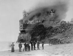 San Francisco, Photo by unknown. The Cliff House Fire, from Ocean Beach. If only they'd rebuilt it as something even half as beautiful. Abandoned Mansion For Sale, Abandoned Mansions, Abandoned Buildings, Abandoned Places, Victorian Buildings, Victorian Era, Cliff House San Francisco, San Francisco California, Cliff House Hotel