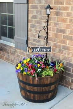 """Flower Barrel, Lamp Post and """"Welcome"""" Sign"""