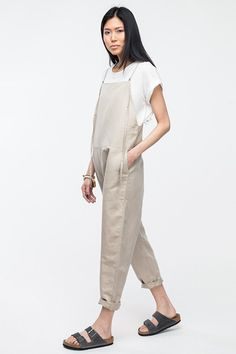 How To Do Overalls Like A Grown-Up #refinery29  http://www.refinery29.com/overalls#slide9  A white tee layered under khaki overalls is simple, but forward.