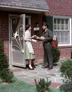 1950's - Housewife in a dress, apron and heels and the mailman personally…