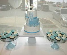 Blue and white batism cake with bears and train