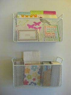 CD wire baskets re-purposed as wall containers/shelves. Great for tight spaces.