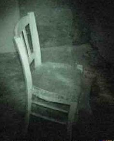 This pic looks like it was taken on an investigation somewhere or possibly a still from a night vision camera. Can you see anything on the chair? You decide HBI Haunted Britain Investigations - it looks like a little child sitting on the chair! Ghost Pictures, Creepy Pictures, Ghost Pics, Ghost Images, Spooky Places, Haunted Places, Haunted Houses, Aliens, Paranormal Pictures
