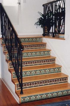 wood flooring on stairs with spanish tile