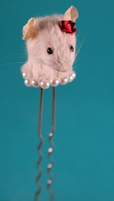 Taxidermy mouse hair pin.