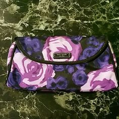NWT kate spade Gemma Giverny Clutch Beautiful! Brand new with all original tags and packing, no duster :( Awesome purple floral pop of color, this is sold out, even used. Large Gemma clutch  - Purple fabric - Black leather - Pouch within - (L) 10 x (H) 5.5 x (W) 1.5 in Smoke and pet free home Please only use the OFFER button kate spade Bags Clutches & Wristlets