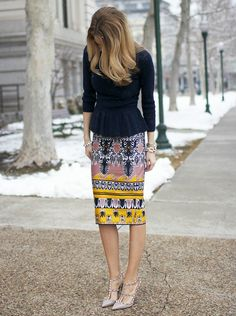 Black peplum top with vibrant printed skirt and nude pumps. Works every time.