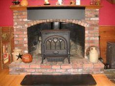 wood stove on raised hearth fireplace