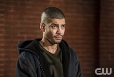 """Arrow -- """"Divided"""" -- Image Number: AR610b_0189.jpg -- Pictured: Rick Gonzalez as Rene Ramirez/Wild Dog -- Photo: Daniel Power/The CW -- © 2018 The CW Network, LLC. All Rights Reserved."""