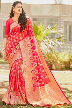 Carrot Red banarasi silk saree with carrot red silk blouse, embellished with woven zari. Saree with Round Neck, Elbow Sleeve. It comes with unstitch blouse, it can be stitched 32 to 58 sizes. #carrot red #banarasi silk #saree #blouse #Andaazfashion #UK