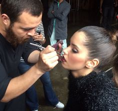 My make-up artist and friend, Oscar Caballero,applying makeup to Miss Honduras.