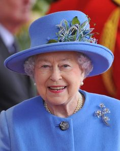 The Queen was wearing an orchid brooch on her coat. A gift from Mappin Webb (jewellers, Royal Warrant-holding silversmiths  and home of the current Crown Jeweller, Martin Swift) in collaboration with Waterford Crystal this brooch includes orchid flowers of hand cut Waterford Crystal with 66 diamonds and rose gold stamens.