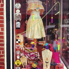 Summer Windows at the store on Cherokee Street!  Jump ropes, place mats, sand box buckets and colorful scarves.  And tiny umbrellas!  #storefront #brickandmortar #retail #windowdressing #cherokeestreet