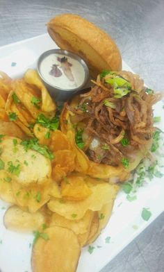 """Dream """"On""""ion burger with balsamic caramelized onions, shoe string onion rings, buttermilk grilled onion ranch."""