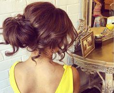 Soft textured undone bun by Natalie Anne Hair Australia.