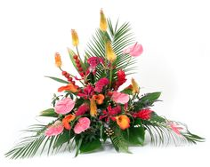 Calla lilies, pink flamingo anthuriums, kniphofia and gloriosa lilies arrangement finished with fresh strawberries.