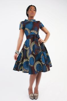 Shrona: A turtleneck collar dress, with a full flare skirt. A simple shortcut to effortless chic. Cotton fabric, fully lined, a zip at the back. #ItsAllAboutAfricanFashion #AfricaFashionShortDress #AfricanPrints #kente #ankara #AfricanStyle #AfricanFashion #AfricanInspired #StyleAfrica #AfricanBeauty #AfricaInFashion