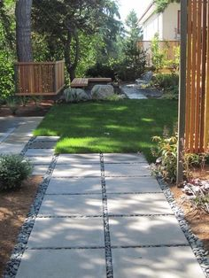 Inexpensive landscape drama with square concrete stepping stones trimmed with pebbles... Next to the slab to extend parking space