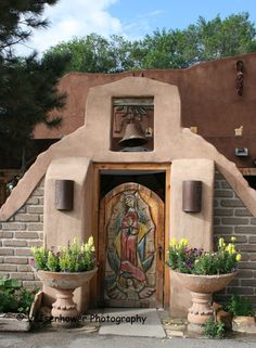 Carved gate of Our Lady of Guadalupe in Cuba, NM. The bell and flowers really add to the urge to enter into this beautiful Church. Spanish Colonial, Spanish Style, Porches, Santa Fe Style, Old Churches, Catholic Churches, Adobe House, New Mexican, Hacienda Style
