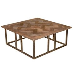 boboli coffee table manufactured by Beau Studio United States Iron base with parquet wooden top. Originally based off of our boboli console table, we have tweeked and changed it to create our new boboli coffee table. Perfect for any sitting room or living room. This rustic style table can still bring sophistication to any room. Comes in whatever size you need. www.lovebeaustudio.com