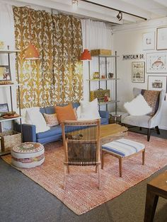Warm studio space, love the ikat curtains