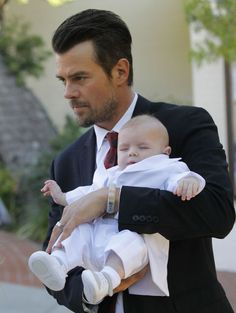 Hello, man candy! Josh Duhamel with his baby boy with Fergie.