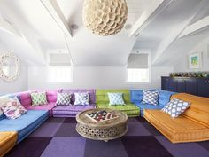 Deep eggplant carpet tiles ground this playful media room's seating area. (http://www.hgtv.com/designers-portfolio/room/eclectic/living-rooms/7936/index.html?soc=Pinterest)