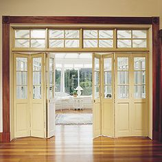 "Interior Bifold Doors with casement windows above. Use solid wood bifold doors with ""casement-style"" windows above in vaulted ceiling area to separate formal living and kitchen areas. Bifold Interior Doors, Bifold French Doors, Exterior Doors, Entry Doors, Double Doors, Front Entry, Interior Folding Doors, Patio Doors, Wood Doors"