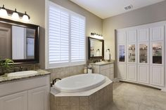 Luxurious Master Bath with Jetted Tub seeded glass display and Linen Cabinet