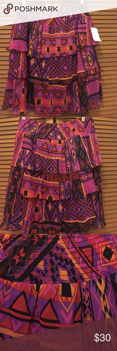NWT Fashion Bug plus size tribal tiered skirt 0X Brand-new with tags! Tribal print tiered skirt from fashion bug in size 0X. Has an elastic waist band. 100% polyester. Waist Unstretched is 16.75 and length is 22.5 inches. Bundle two or more items from my closet save! Fashion Bug Skirts