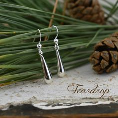 Our Teardrop Earrings come to you in sterling silver easy to slip on hooks.  Earrings measure approximately 34mm long (that's 1.33 inches in girlfriend lingo).  These earrings are lightweight enough to wear all day without feeling weighed down but are not so small that they go unnoticed.