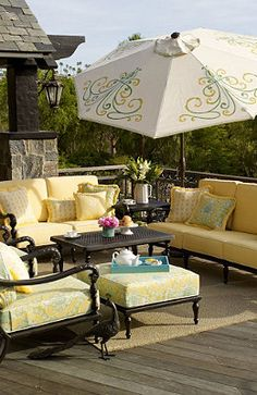 Pretty umbrella - and I LOVE the furniture!!! Next time I update my lawn furniture I might go with oil rubbed bronze paint and yellow cushions!!! LOVE the detail on the umbrella too! Hmmm... SO tempted to do it now!!!