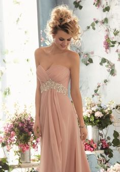 So elegant - we are in love with this Fross Collections gown!