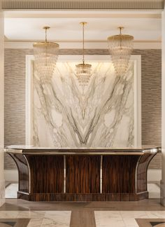 Calacatta Gold Borghini Extra Marble Feature Wall at The Stoneleigh Lobby by Dallas Design Group