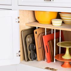 Prevent flat items like cookie sheets and cutting boards from piling up, too, with tension curtain rods spaced between firmly installed shelves.